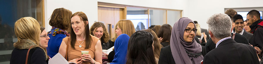 People mingling at a School of Health Sciences event