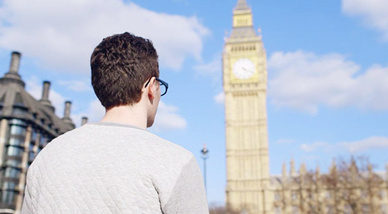 A male student looking at Big Ben