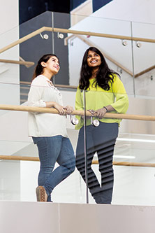Two City students in a City building