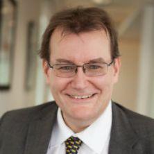 Portrait of Dr Wayne Holland