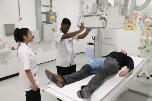 Radiography machine with students and patient