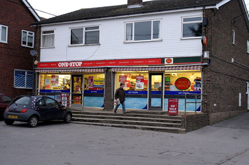 Image of a convenience store standing alone in a town.