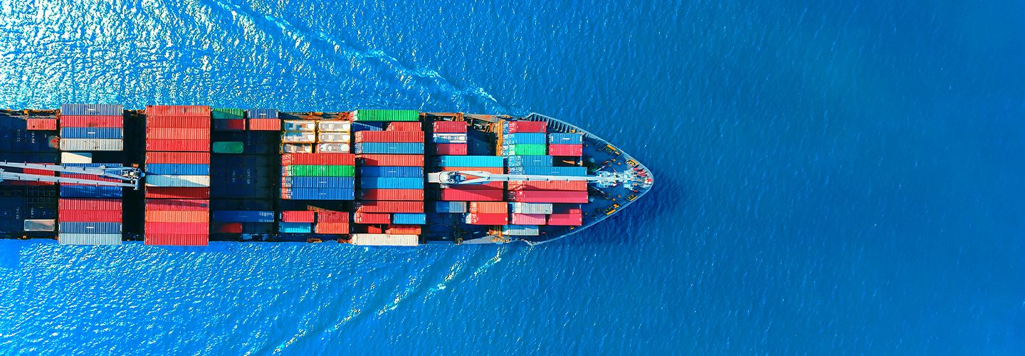 Aerial view of container ship at sea