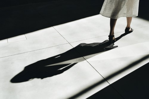 Shot of woman walking casting a silhouette