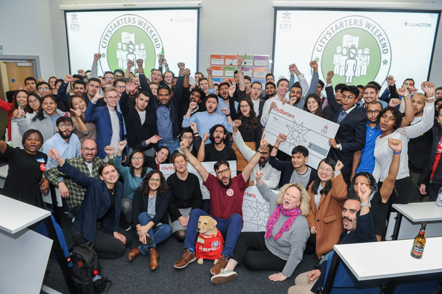 City students at City Starters Weekend including GreenLO2 and E-TukTuk with their funding cheques.