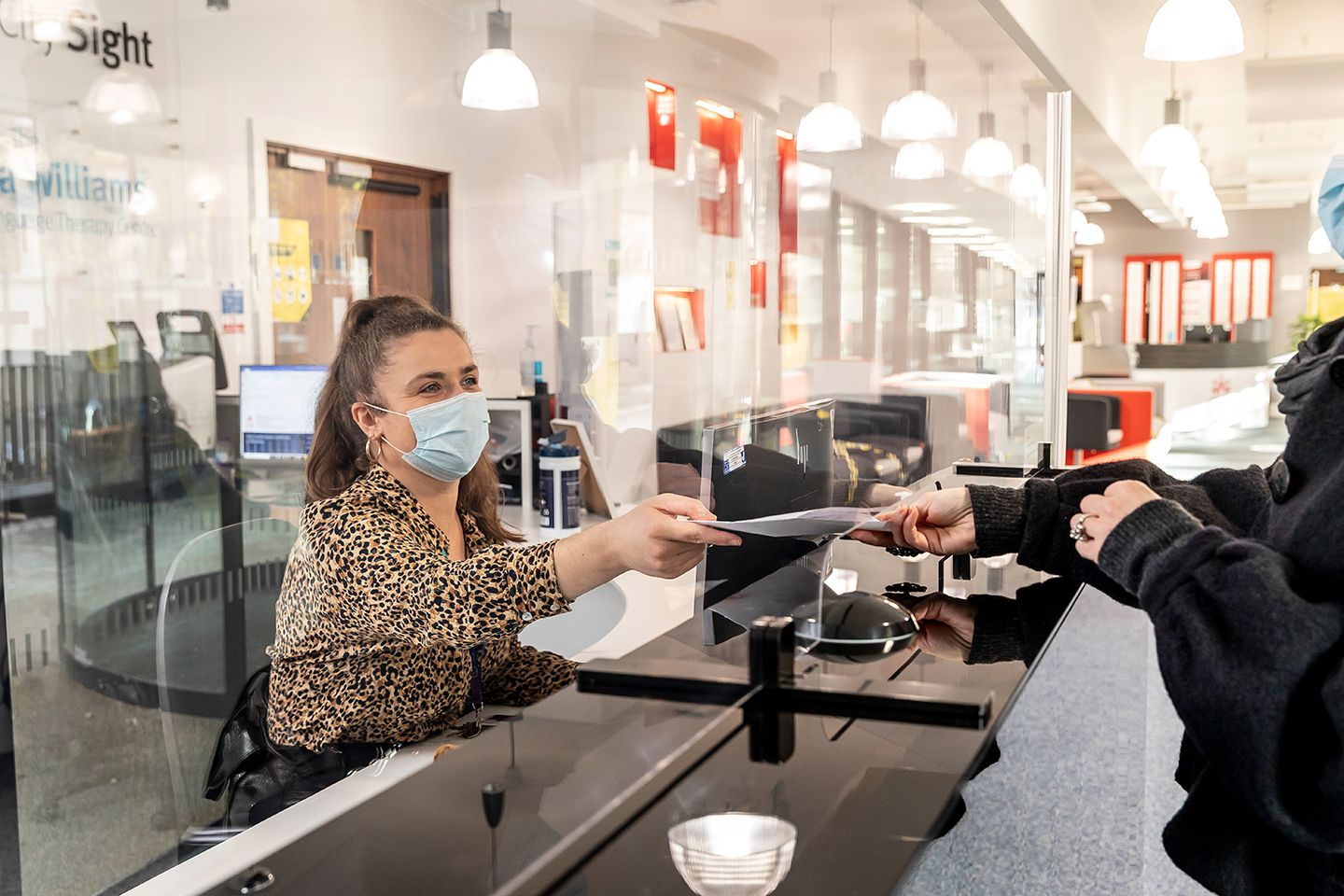 City Sight receptionist wearing a mask