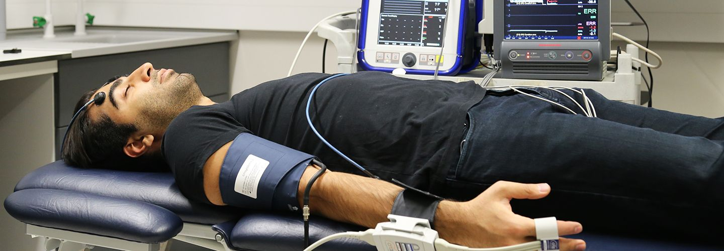 Pulse oximeter sensors attached to man laying down