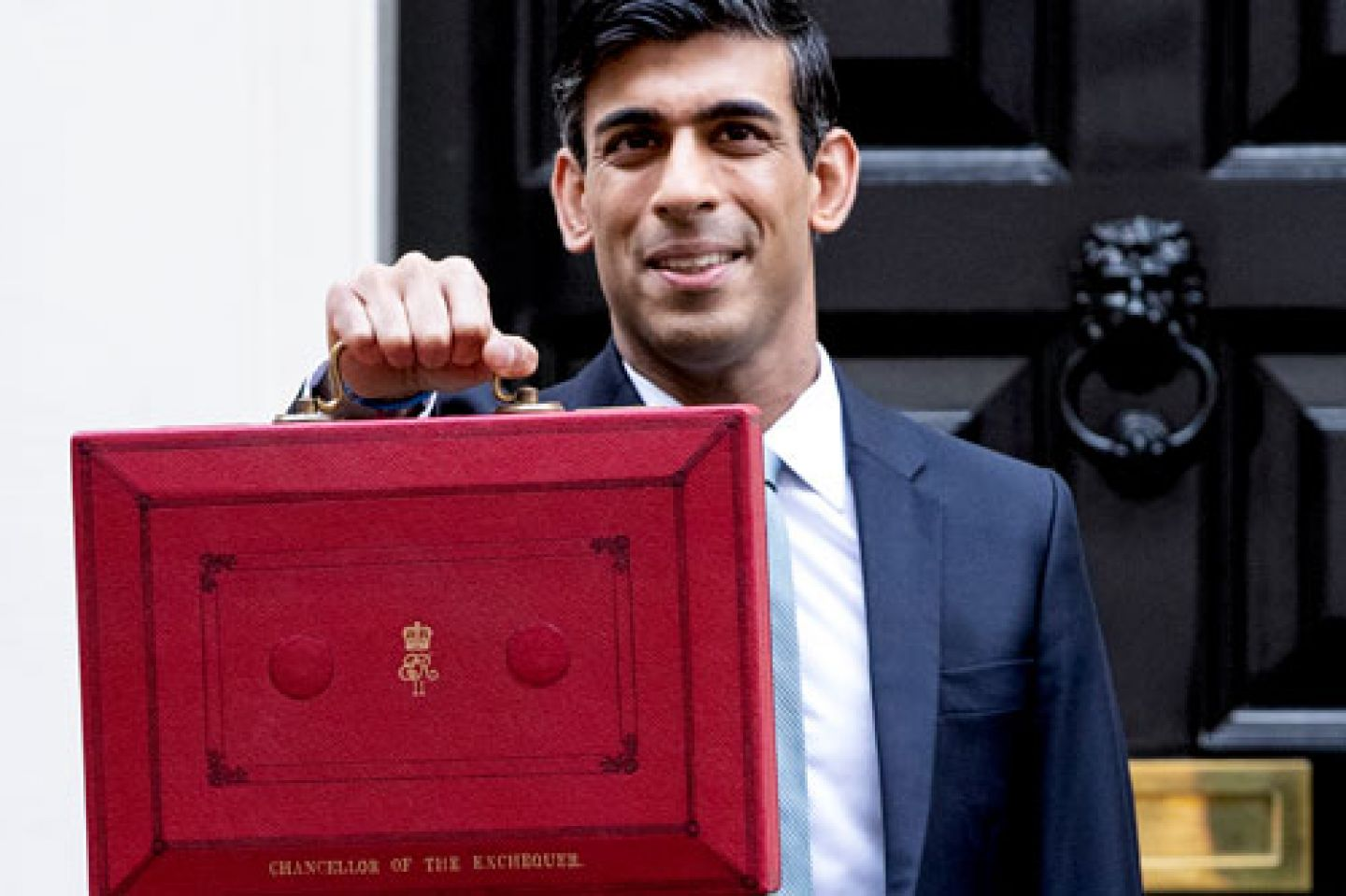 Chancellor Rishi Sunak holding the red Budget briefcase outside 10 Downing St