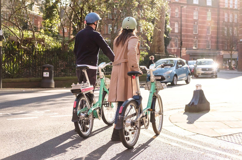 Two people walking with beryl bikes