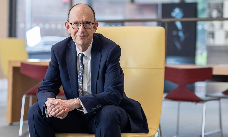 Professor Anthony Finkelstein sitting in the Pavilion July 2021