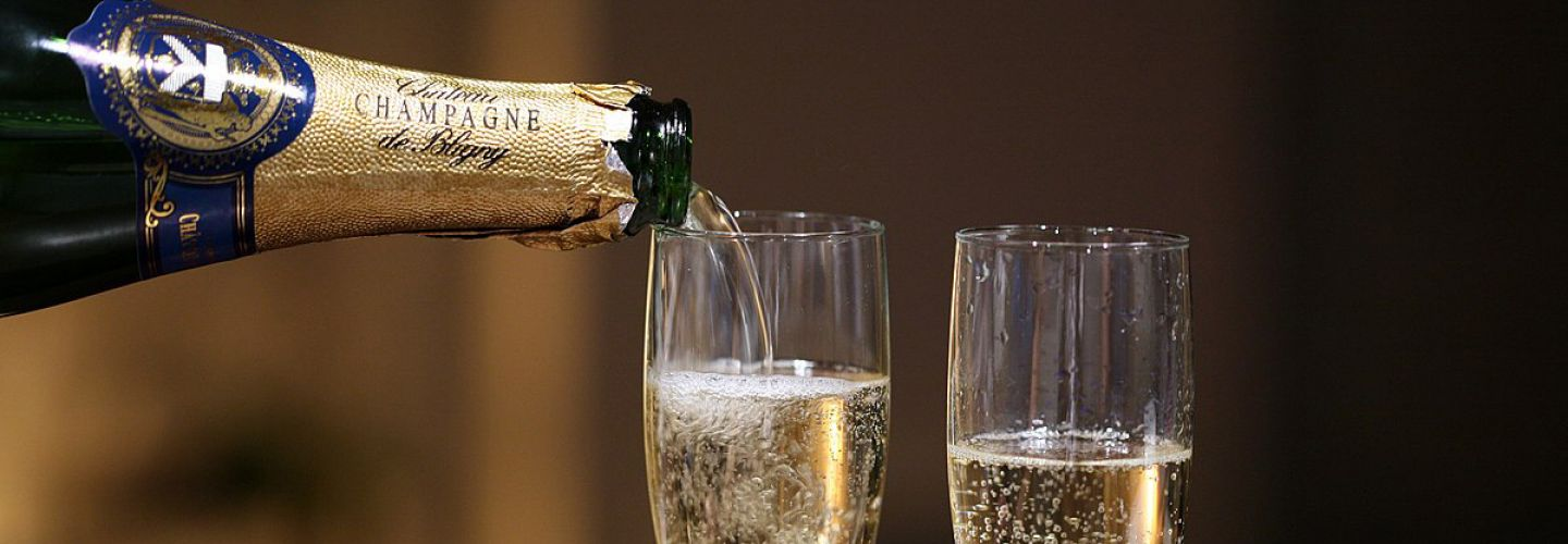 Pouring champagne banner.