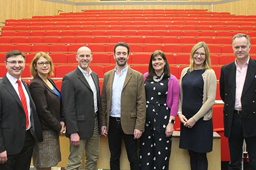Professor Chris Greer and Dr Jutta Mortlock with panellists and moderator of the 'Mindfulness, Wellbeing and Performance in High-Stakes Contexts: The New Frontier' event