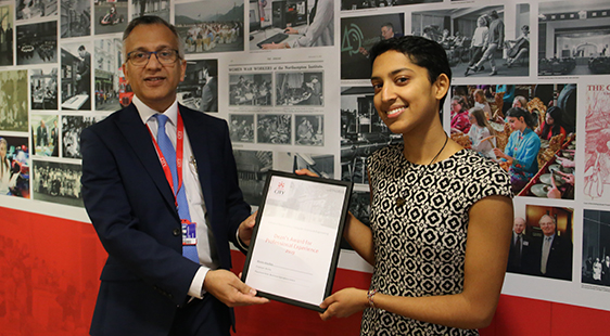 Dean Raj awarding a certificate to a student