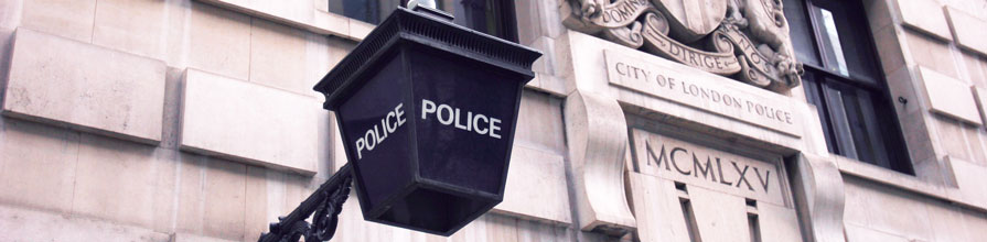 Police sign on a building in London