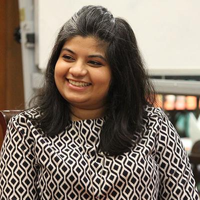 Niyati Joshi smiling