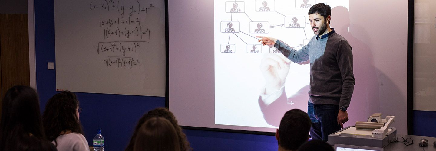 Male academic presenting in a room