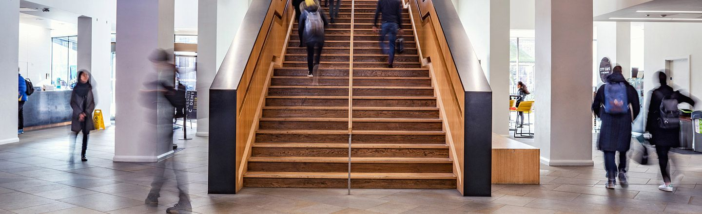 Students walking up the staircase