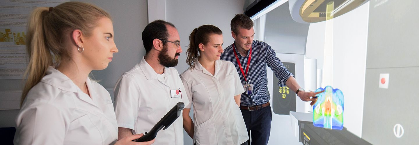 Male academic and students viewing radiography virtual environment on screen