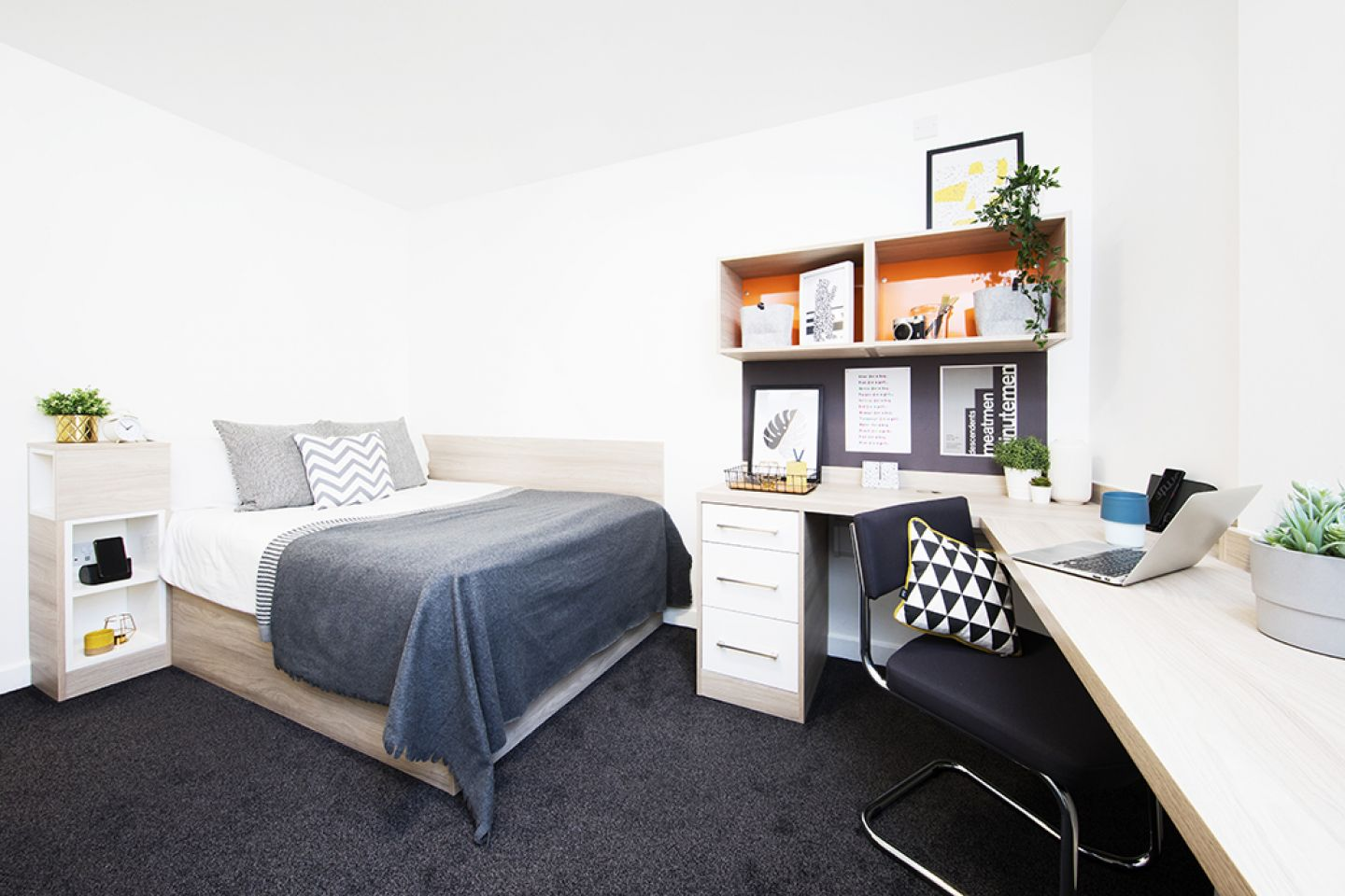 Arbour house bedroom with double bed and desk