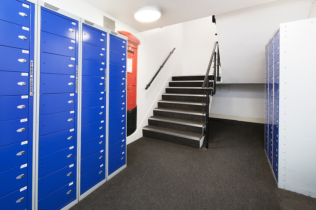 Romano court post box lockers next to staircase