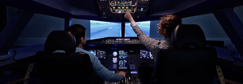Students using a flight simulator