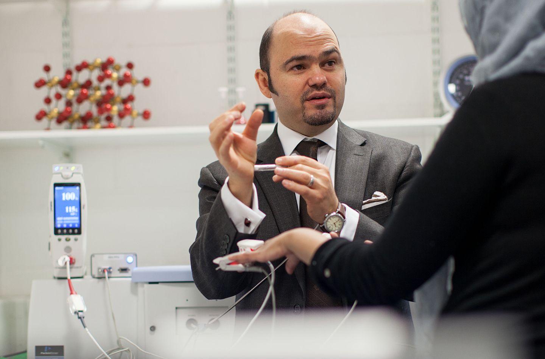Professor Panicos Kyriacou carrying out a diagnosis