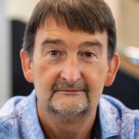 portrait of Professor David Crabb