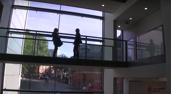 Two students stand on the fifth floor of the Rhind Building