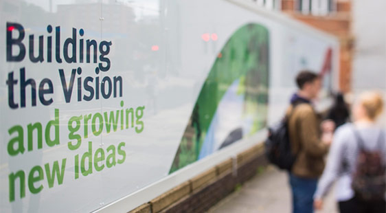 A sign on a building which reads: Building the Vision and growing new ideas