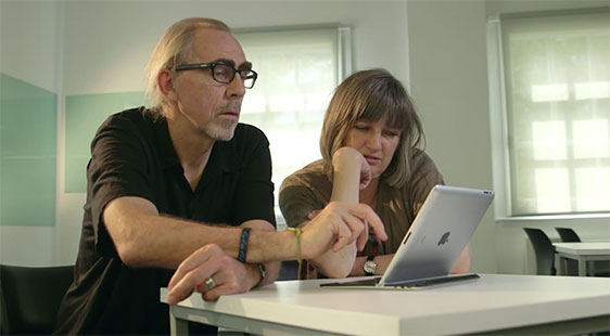 Image of 2 people looking at an ipad