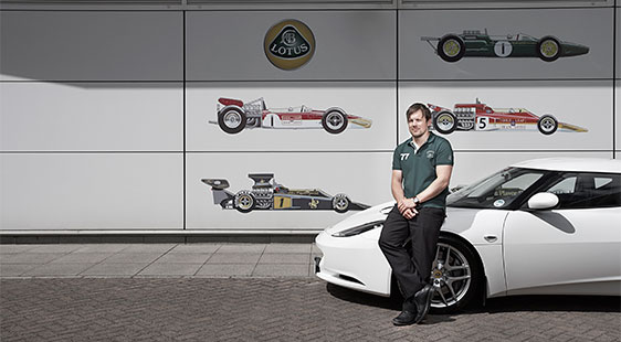City placement student Sean Canty with a Lotus car