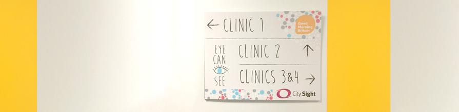 Good Morning Britain and City Sight sign: left clinic 1, up clinic 2, right clinics 3 & 4