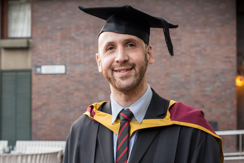 Adrian Bradley in his graduation robes