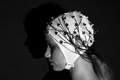 Alex wearing an EEG cap
