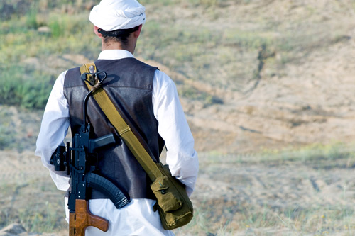 Muslim rebel with rifle. Taliban-in-disarray-Professor-Theo-Farrell