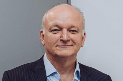 A portrait photograph of Mr Paul Streets OBE.