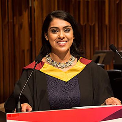 Deepkiran Cheema smiling in graduation attire