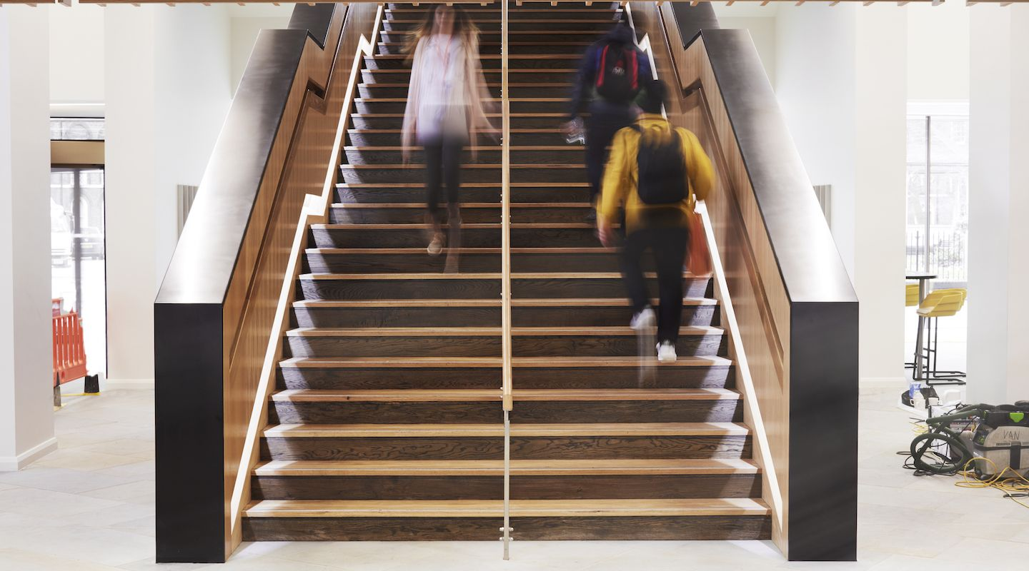 Students walking on stairs in the main entrance