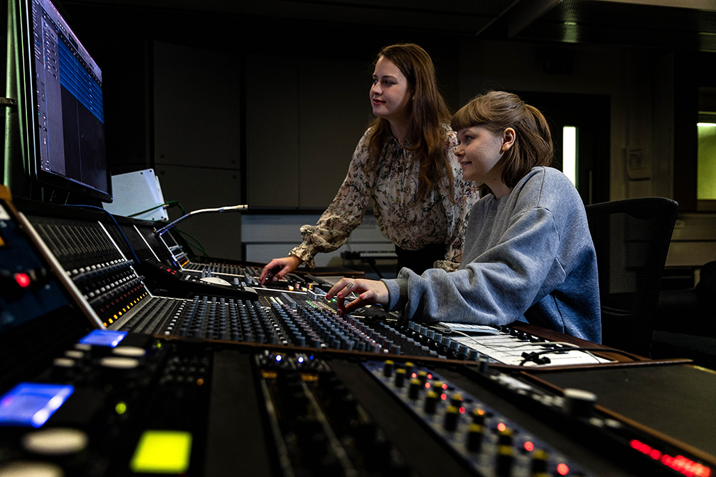 Two female students in music mixing studios
