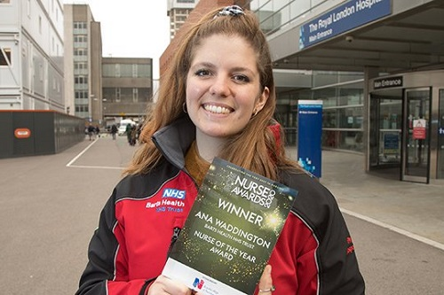 Ana Waddington, Nurse of the Year 2020, holding up her award outside Royal London Hospital