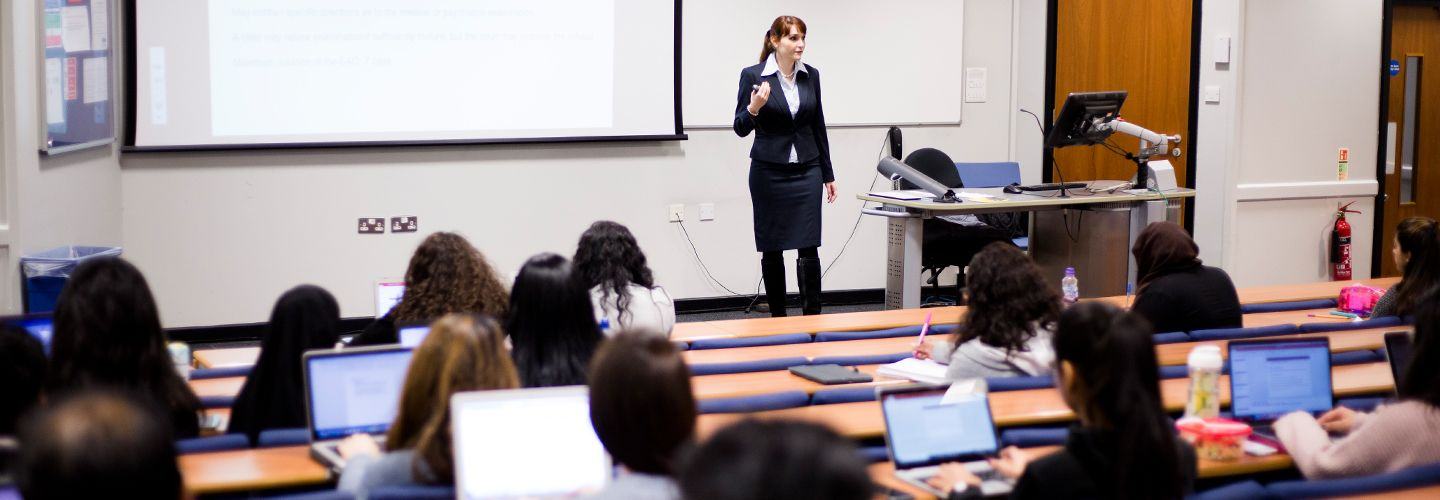 Female academic presenting to room full of law students
