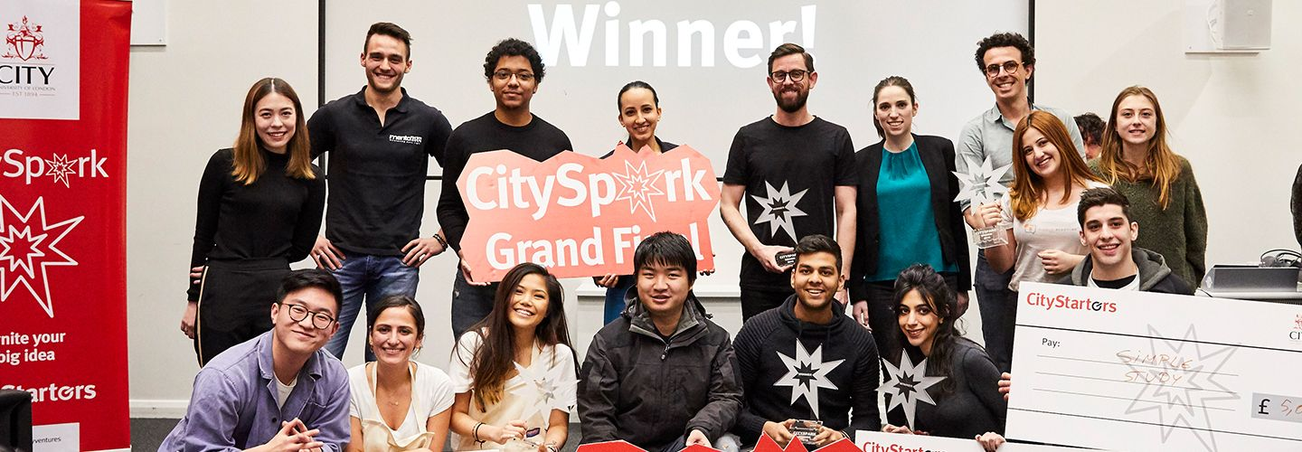 City spark grand finale winners smiling and holding cheques