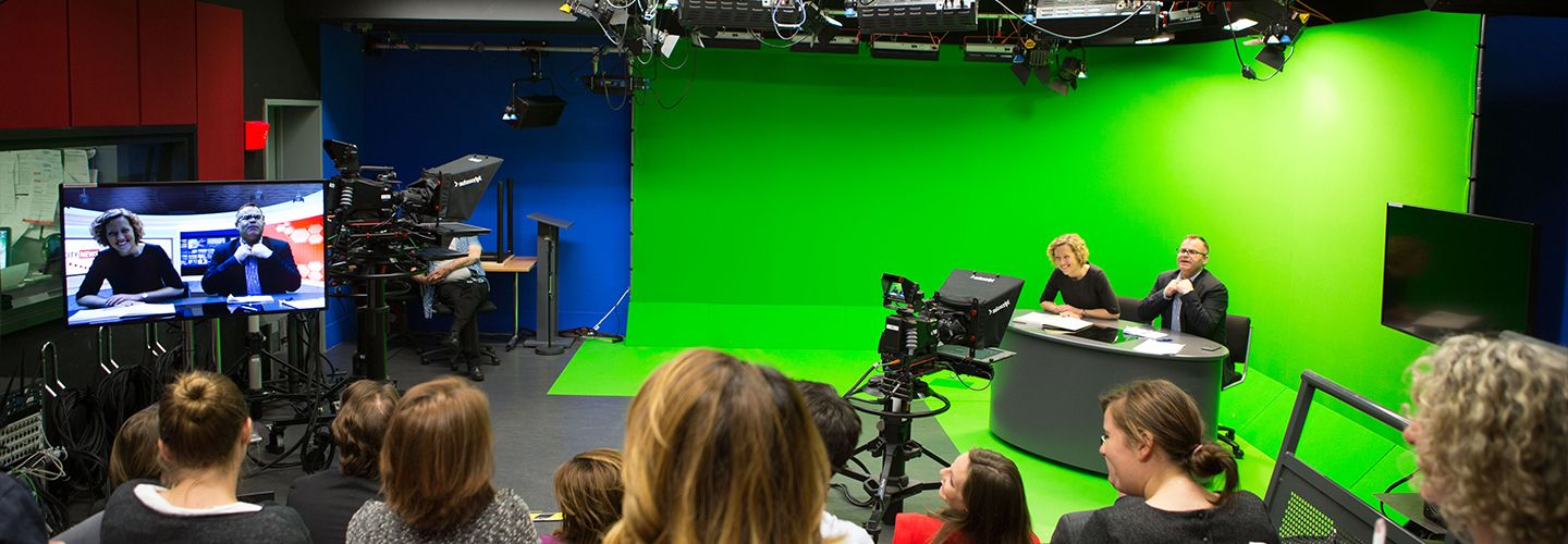 Presenters and audience in a television studio