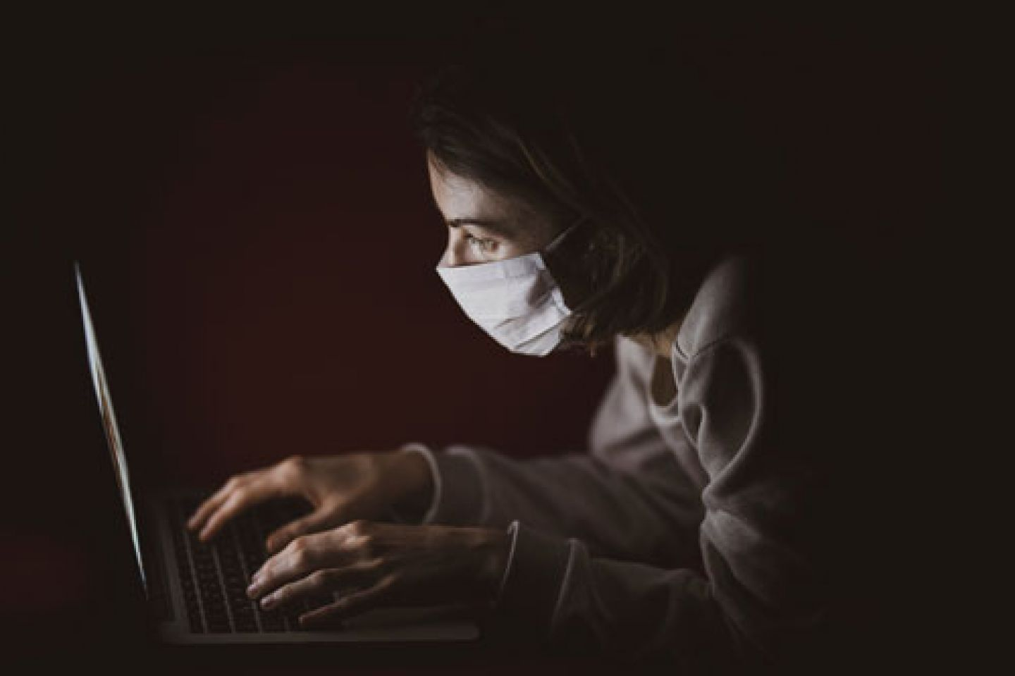 Stock photo of a reporter in a face mask