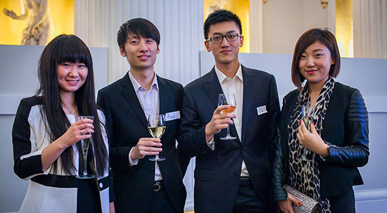 Students raising a toast at International Students Welcome Reception