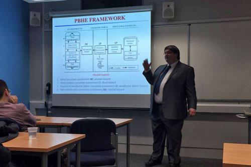 Professor M. Barbato presents a power point slide on PBHE Framework