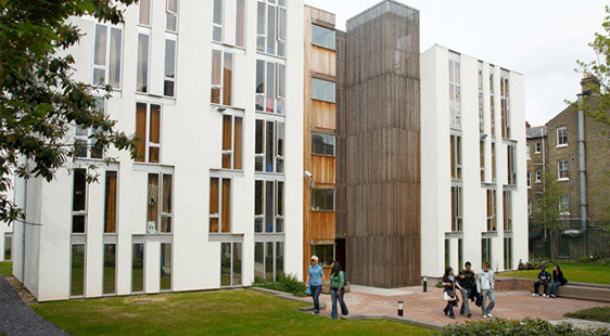 Students walking outside Alliance House, a hall of residence