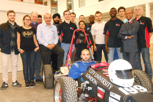 City Racing Team gather round a Formula Student sitting in a car