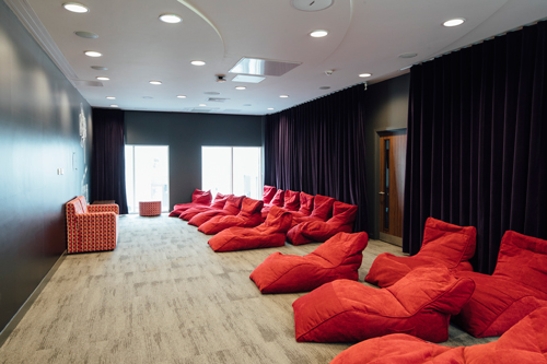 Soft red lounge chairs in a room at Cartwright gardens student accommodation.