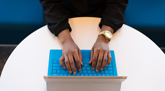 Top down image of student using a laptop